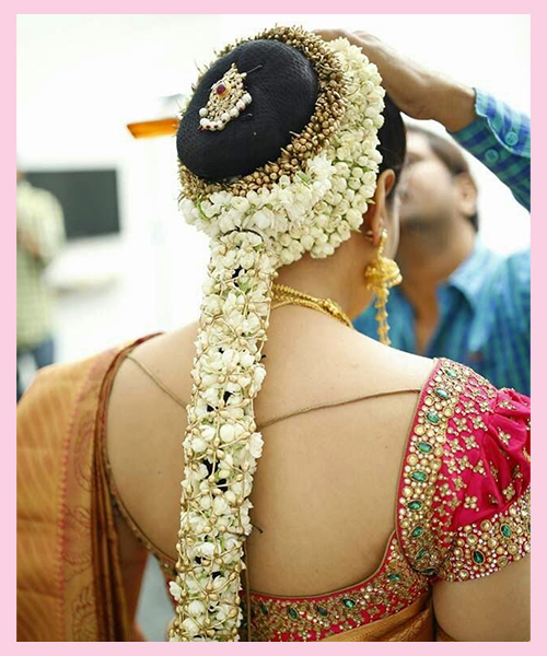 All-Over-Flowers bridal hairstyle for Indian Brides