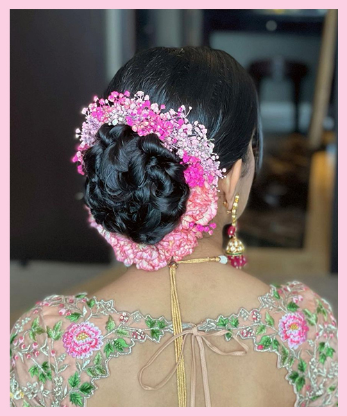 Classic-bun-with-flowers bridal hairstyle for Indian brides