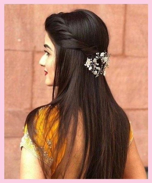 Simple and straight bridal hairstyle for Indian brides